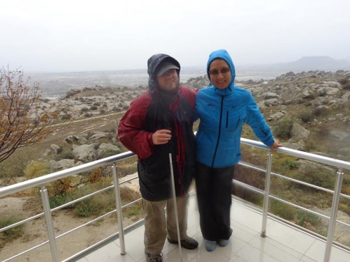 Tony with a Chinese tourist on a viewing platform at Gobustan Petroglyph Reserve.
