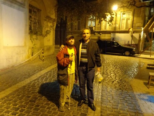 Evening. Tony standing with a local man he met on the plane from Istanbul in Baku's old town.