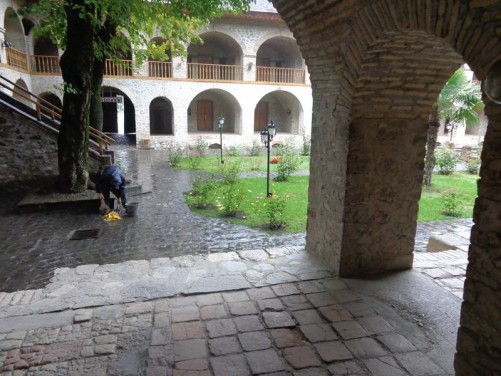 Looking into the central garden courtyard of Sheki's Caravansarai. Caravansarais were roadside inns for conveys of travellers (known as caravans) passing along established routes, typically in remote or dangerous areas. This caravansarai dates from the 18th-19th centuries and served travellers on the Silk Road to and from China.