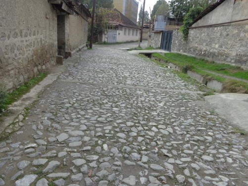 A quiet cobblestone street in a residential part of Shaki.