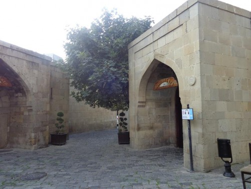 Stone entrance into the 15th century Bukhara Caravanserai, now a restaurant.