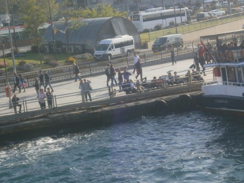 View of a waterside promenade busy with people. This is on the edge of the historic Sultanahmet district.