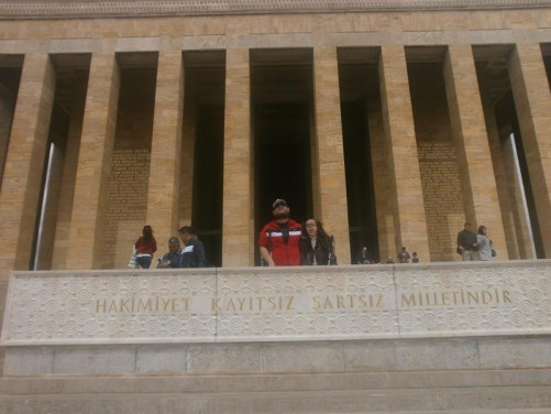 Tony and Tatiana outside the Hall of Honour. Behind tall square columns support the main entrance portico.