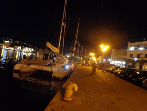 Evening view of Mytilene's large harbour. Sailing boats moored in front.
