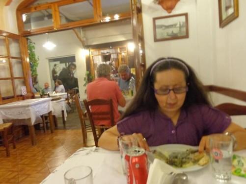 Tatiana eating in a restaurant.