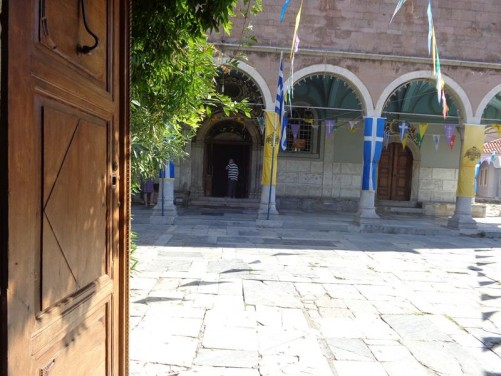 View through an entrance gate into the courtyard outside the Church of Panayia (Church of the Virgin Mary).