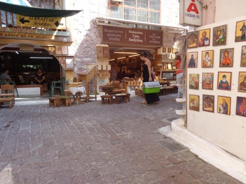 At the intersection of two narrow streets. Small religious icons for sale on a wall to one side.
