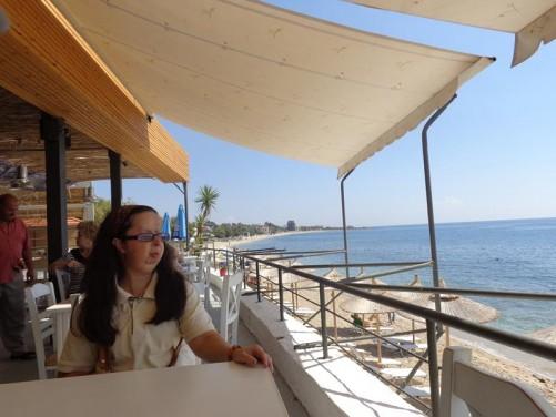 Tatiana sitting at a pleasant beach side café at Plomari.