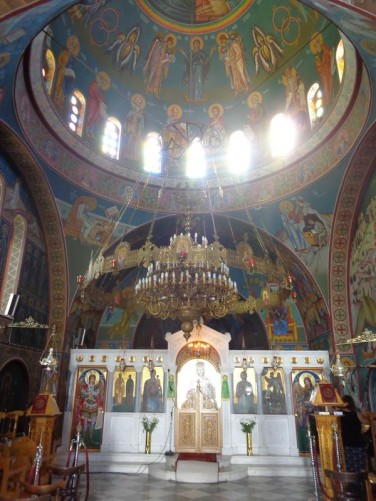 Looking towards the main altar. A large dome above colourfully painted with frescos.