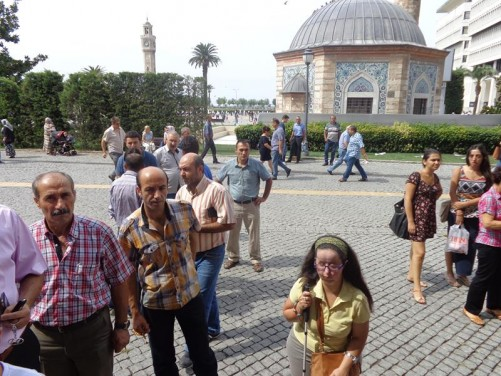 Tatiana in Konak Square. Behind her, Yali Mosque can again be seen. The building is octagonal in shape with a domed roof. The outer walls are decorated with tiles.