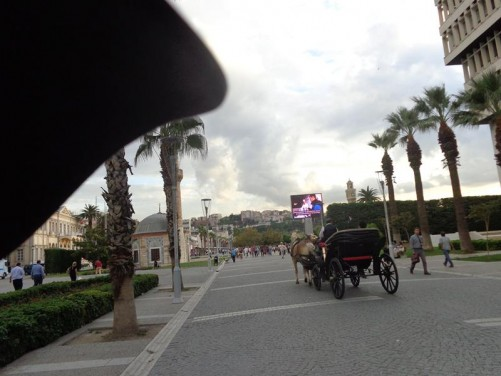 View into Konak Square. A horse and cart carrying tourists passing by.