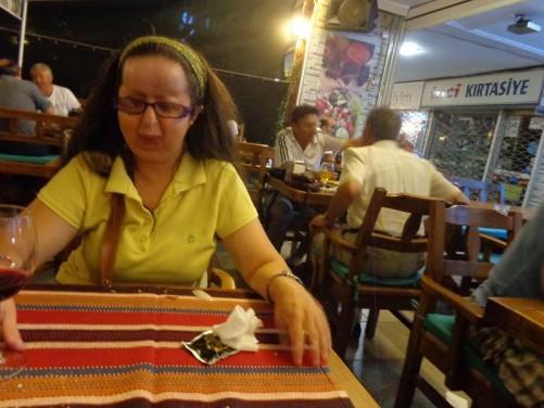 Tatiana sitting in a restaurant.