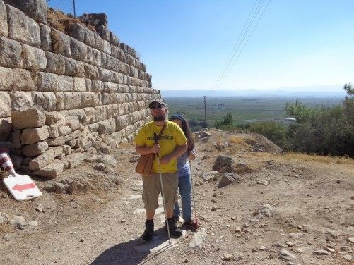 Tony and Tatiana by the town walls. These fortified walls, built out of large stone blocks, surround the site. They are two metres thick, with towers at intervals, and with three principal gates.