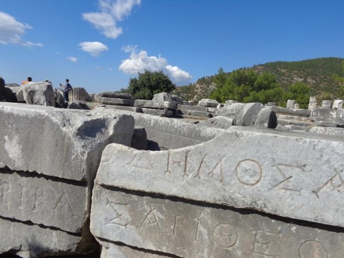 Big stone blocks with Greek lettering carved on the front.