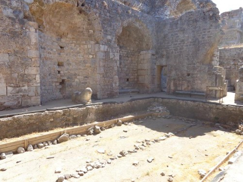Ruins of the Faustina Baths. This was the frigidarium (cold room). An empty pool in front with a stone lion sitting at the far side. This extensive bath complex was built between 161 to 180 AD under the patronage of Faustina, the wife of the Roman Emperor Marcus Aurelius.