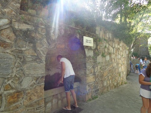 A drinking fountain in a wall alcove near the House of the Virgin Mary. The water comes from an underground spring and is said to be holy.