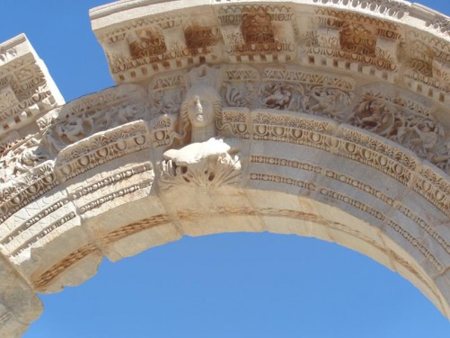 Decoration on an arched entrance to Hadrian's Temple. A female head in the centre.