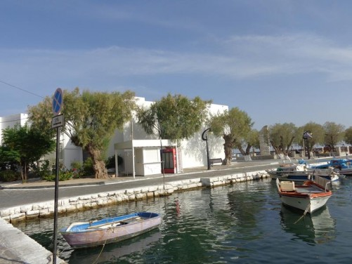 A quiet part of Samos harbour with small fishing boats in the water.