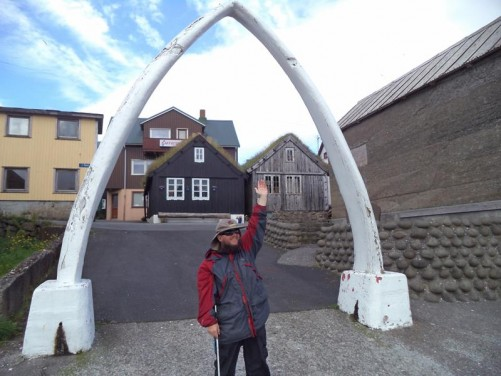 Tony under a whalebone arch on Nólsoy. This small inhabited island is 5 kilometres (3 miles) east of Tórshavn. It has a tourist office and café.
