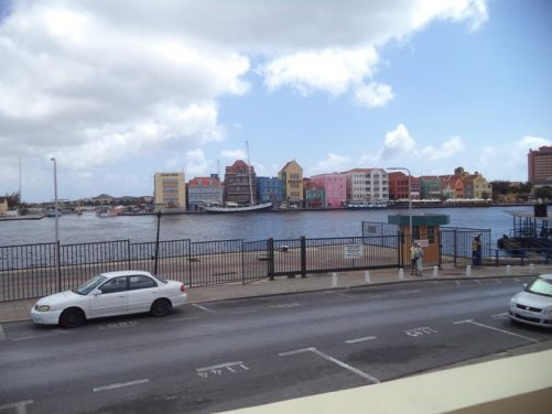 Looking across St Anna Bay to attractive waterfront buildings in Punda quarter painted in pastel colours.