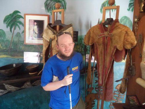 Tony next to lion-skin clothes of Emperor Haile Selassie of Ethiopia.