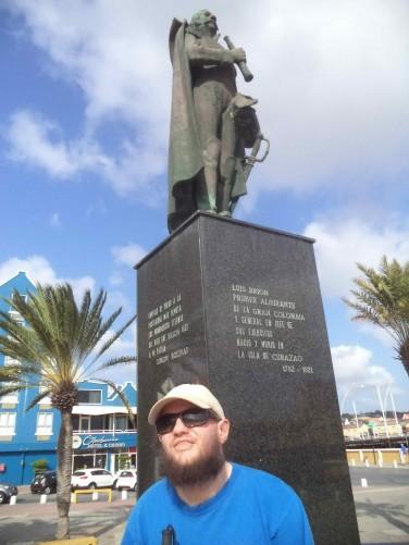 Another view of Tony beneath the Pedro Luis Brión statue in Plaza Brión.
