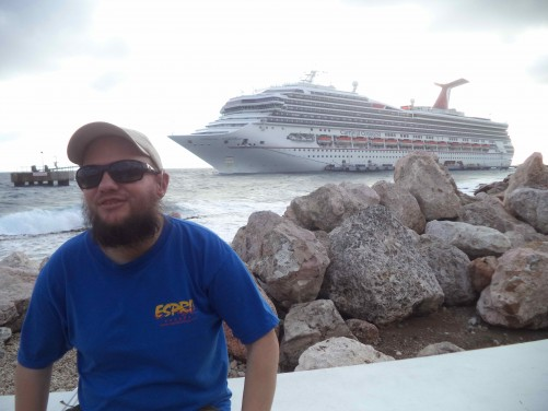 A cruise ship anchored at Willemstad. Tony on the beach in front.