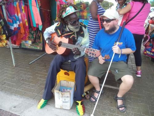 Tony sitting with a Rasta man at the souvenir market in Otrobanda, Willemstad.
