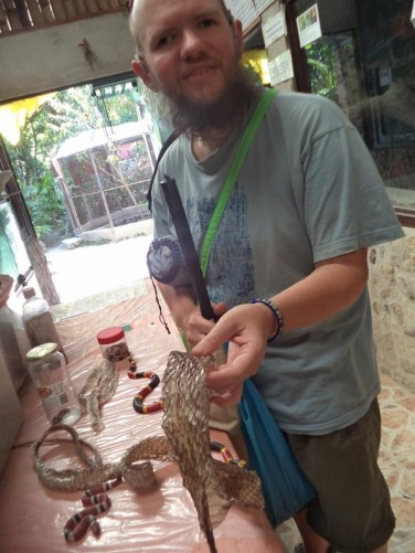 Tony examining the skin shed by a snake at El Serpentario snake centre. Most snakes shed their skin 4-8 times per year.