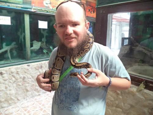 Tony holding a 1.5 metre python named Lola.