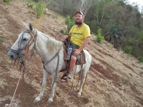Tony riding a horse on Ometepe Island.