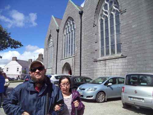Outside St Nicholas' Collegiate Church (Church of Ireland). This is, allegedly, the largest medieval church still in everyday use in Ireland. It was founded in 1320 and enlarged in the following two centuries. It is in the heart of the old city.