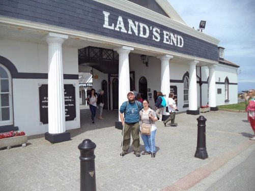 Tony and Tatiana in front of the entrance arch, near the Land's End Visitor Centre.