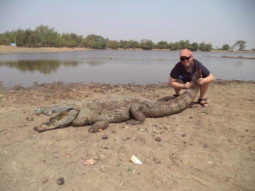 Tony holding the crocodile's tail.
