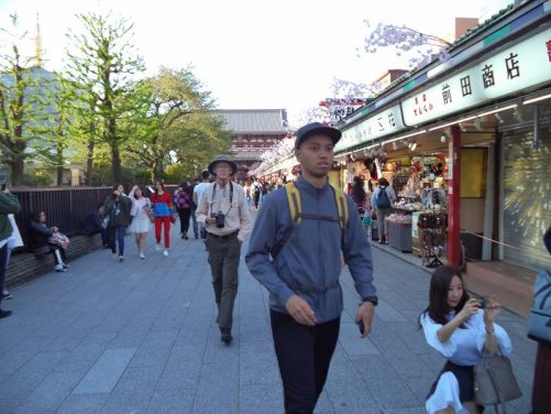 Street scene with part of Sensoji Temple just visible in front.