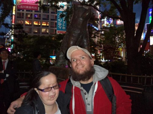 Tony, Tatiana with a statue of Hachiko. Hachiko is a famous Tokyo dog who found notoriety from waiting daily at Shibua train station for his master to return and continued this vigil for several years after his master's death. 23rd April.