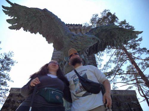 Tatiana and Tony beneath an eagle sculpture at Aoba Castle (Sendai Castle).