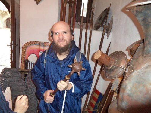 Tony holding an iron or steel mace. A long metal handle atopped with a spiked ball.