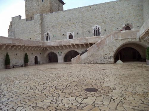 View of the lower courtyard. A stone tower partly in view.