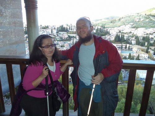 Tatiana and Tony by a balcony inside the Nasrid Palace.