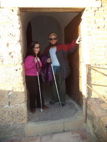 Tatiana and Tony standing in a doorway at the Alcazaba.