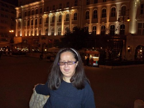 Tatiana in Vörösmarty Square. Grand façade of Cafe Gerbeaud in the background.