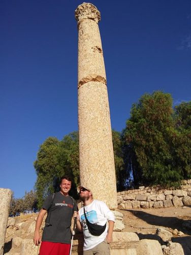Brent and Tony in front of a stone column.