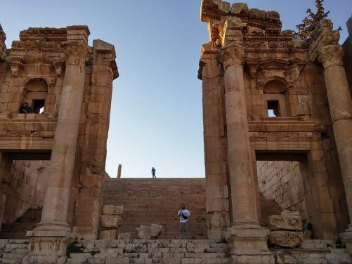 Tony in the central gate of the Propylaeum with a long wide flight of steps up to the Temple of Artemis behind.