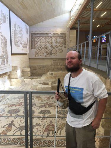 Tony in a room containing Byzantine mosaics at Mount Nebo.