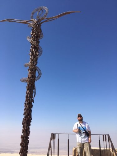 Tony on a viewing platform with the Brazen Serpent sculpture standing along side. The sculpture symbolises the bronze serpent taken by Moses into the desert and the cross upon which Jesus was crucified.