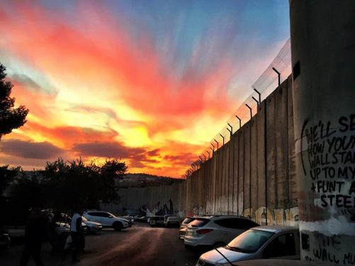 Amazing sunset at the border wall.