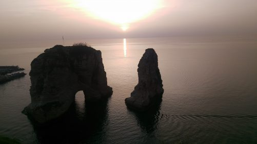 The sun setting over Pigeons' Rock or Sabah Nassar's Rock (also known as the Rock of Raouché). This rock formation is in Beirut at the end of the Corniche (Avenue de Paris) in the upscale Raouché neighbourhood.