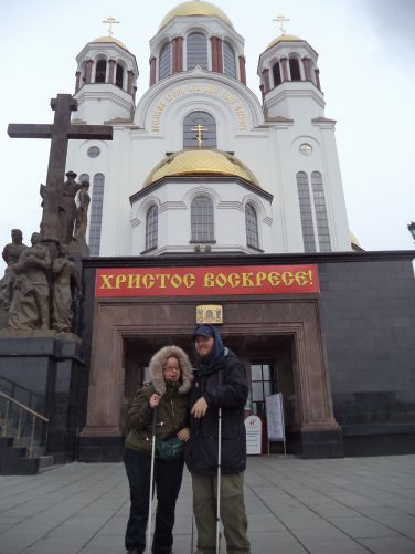 Tony and Tatiana outside an entrance to the church. The church is painted white with gold domes on the roof. Construction of the church began in 2000 and it was consecrated in 2003.