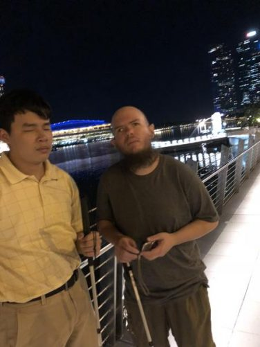 Tony and Johnny on a viewing deck next to the Singapore River.
